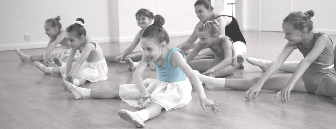 young dancers sitting on teh floor pretending to be witches during class