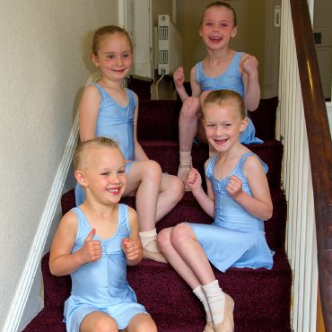 image showing young primary dancers cheering on the stairs