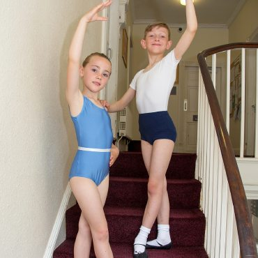 Image showing a young girl and boy dancer posing on the stairs