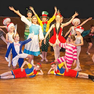 image showing a group of young dancers at the end of their Alice in Wonderland Dance