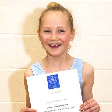 Image showing young female dancer showing her exam certificate