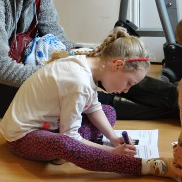 Image showing young child completing a workbook