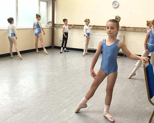 Image showing young dancers mid tendu at the barre