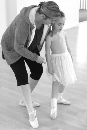 image showing teacher instructing a young dancer