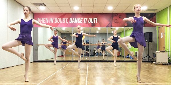 Image showing a class of young dancers mid pirouette