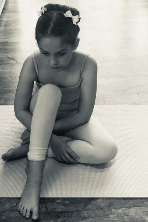 Image showing young dancer sitting on her yoga mat