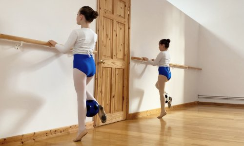two young dancers at the barre