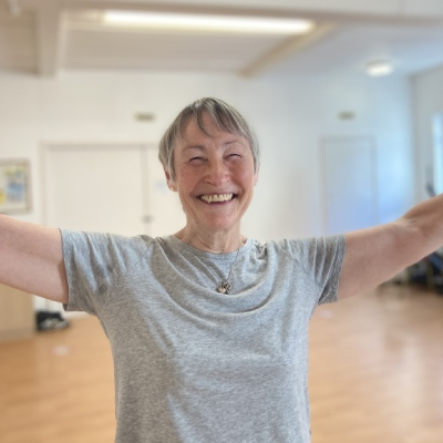 Adult dancer smiling in class